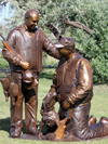 Greenbrier Resort owner and billionaire philanthropist, Jim Justice, Jr. and father hunting scene bronze sculpture with grouse, hunting dog, Stephen Bechtel commissioned monumental portrait bronze sculpture, BSA Summit, Boy Scouts of America, Summit Bechtel National Family Scout Reserve, SBR, West Virginia, high adventure base camp scouting, memorial portrait sculptor Tom White, of Prescott, Arizona, 2013 Jamboree dedication of statues, commission a bronze sculpture monument, portrait sculptures of, Walter Scott, Paul Christen, James & Jim Justice, J.W. and Hazel Ruby, Wayne Perry, Jack Furst, Bob Mazzuca, Senator Joe Manchin