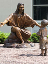 """Christ Our Rock"" lifesize monument and tabletop bronze statues by Tom White, Christian Monumental Bronze Sculptor, placed in Tannersville, Pennsylvania and Gatesville, Texas at the Davidson Memorial Prayer Garden Christian sculptures, tabletop Biblical faith-based sculptures, statue of Christ, public monument, statues of Jesus welcoming children, Jesus Christ sculptures, religious monumental bronze sculptures"