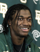 RG3 bronze statue, Robert Griffin, III portrait bronze sculpture of 2011 Baylor Heisman Trophy winner, Washington Redskins quarterback, Baylor University football stadium sculptures, NFL statues, Tom White monumental bronze sculptor, figurative statues in bronze, public monumental bronze sculptures, monumental bronze statues, public bronze historical monuments, portrait bronze memorial monuments, memorial sports figure statues, public art, monumental sports sculptures, football sculptures, baseball statues, College Baseball Foundation, basketball memorial bronze statues, golf sculptures, soccer sculptures, football statues, sports trophies, Brooks Wallace award trophy