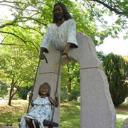 Monumental bronze memorial sculpture of Sami McDonald with statue of Jesus swinging her, Cavehill Cemetery commemorative portrait bronze by Christian Sculptor Tom White.  Children and Jesus sculptures in lifesize and monumental bronze, sculptures of Christ