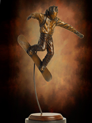 Bronze tabletop Snowboarder sculpture, snowboarding award trophy, custom designed trophies by Tom White, original sports trophies, action snowboard sculpture, figurative sports sculptures, portrait bronze sports statues, public sports monuments, Little League baseball sculptures in bronze, baseball ballpark statues and monuments, sports arena statues, monumental bronze sports sculptures, bronze sculptures of boys playing baseball, commission sports award trophies, skiing statues