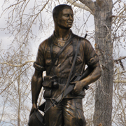 Bronze monumental Vietnam War soldier sculpture, Plainview Memorial, Big Piney, WY, Tom White, Monumental life-size bronze statue, Medal of Honor recipient, public war memorials, figurative bronze portrait sculptures of soldiers, military war memorial monuments, portrait sculptures of soldiers, veteran memorials, coast guard statues, army soldier sculptures, air force soldier monuments, army soldier portrait bronzes, bronze monuments of marine soldiers,  figurative portrait bronze memorials of military personnel, life-size bronze statue of a Gold Star Mom, public monumental heroic military bronze commissions, commission a sculpture of a soldier