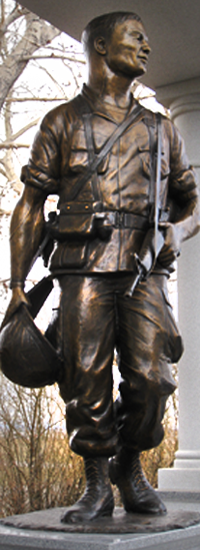 Vietnam soldier bronze sculpture, Plainview Memorial, Big Piney, WY, Monumental life-size bronze statues of Medal of Honor recipients, including Sp5c Clarence E. Sasser, life-size bronze statue of a Gold Star Mom, 40-ft. Brazoria County Ring of Honor in Angleton, Texas; MOH Pfc. Emory L. Bennett, Riverside Park, Cocoa, FL; portrait bronze sculpture of MOH Marine Kenneth Worley.  Created by Tom White, figurative monumental bronze sculptor, public war memorials honoring soldiers, military sculptures - Army, Air Force, Navy, Marines, Coast Guard, historical war memorials, Civil War monuments, Buffalo soldiers, commission a sculpture of a soldier hero, heroic military sculptures